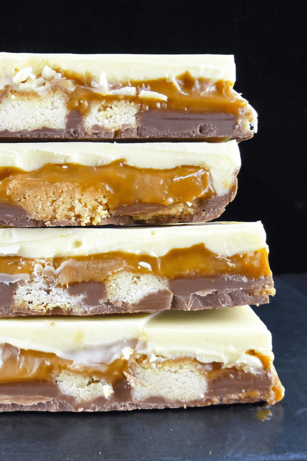 This caramel shortbread chocolate bark recipe is a simple no bake candy with gooey caramel, rich spelt shortbread and both white and milk chocolate.