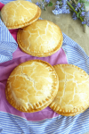 an image of several individual pies on a pink and purple cloth