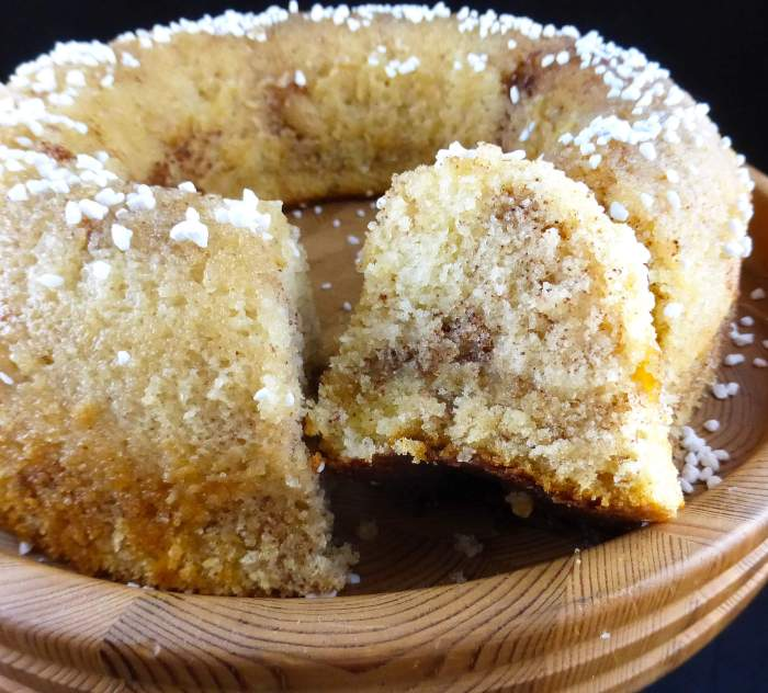 picture of a round sugar cake with two slices cut out