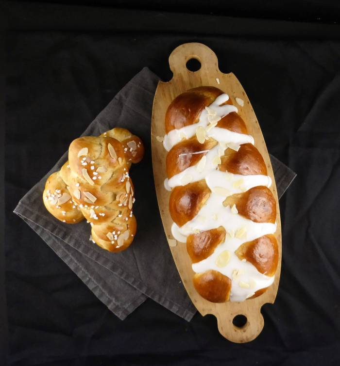 picture of a large loaf and two small plaits of cardamom bread
