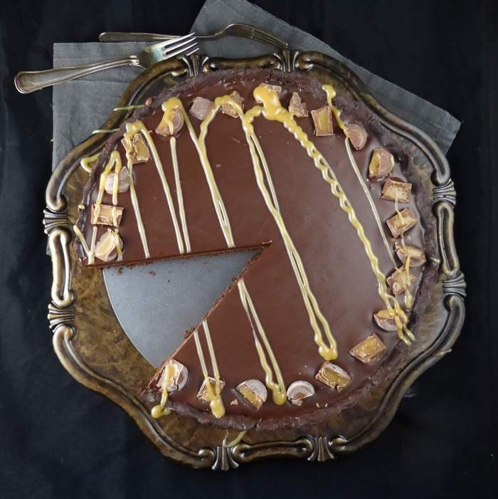 a picture of a chocolate pie with a slice missing
