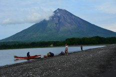 Local fishermen and Volcan Concepcion from the spit