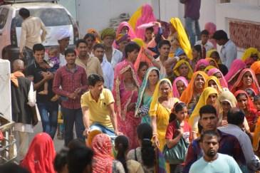 Many colourful lady pilgrims