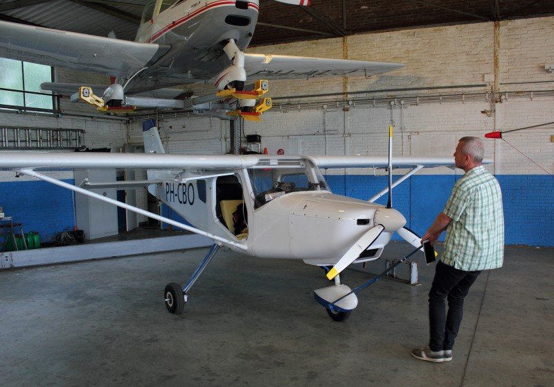 Jeroen pulls his airplane from the hangar