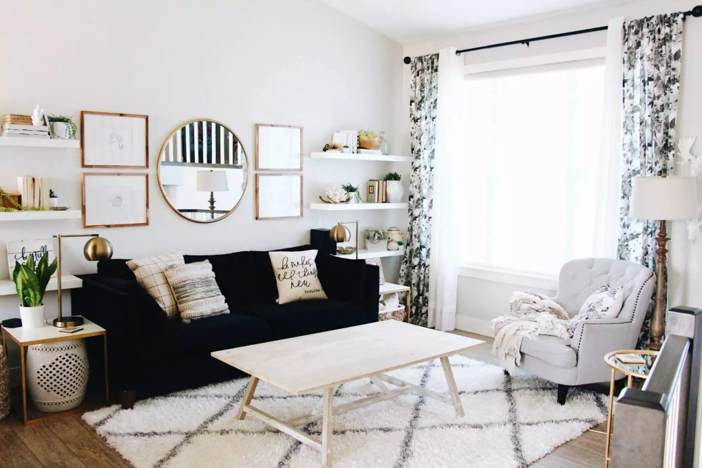 living room with black couch and gallery wall