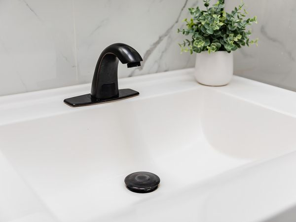 how to replace the drain trap on a sink