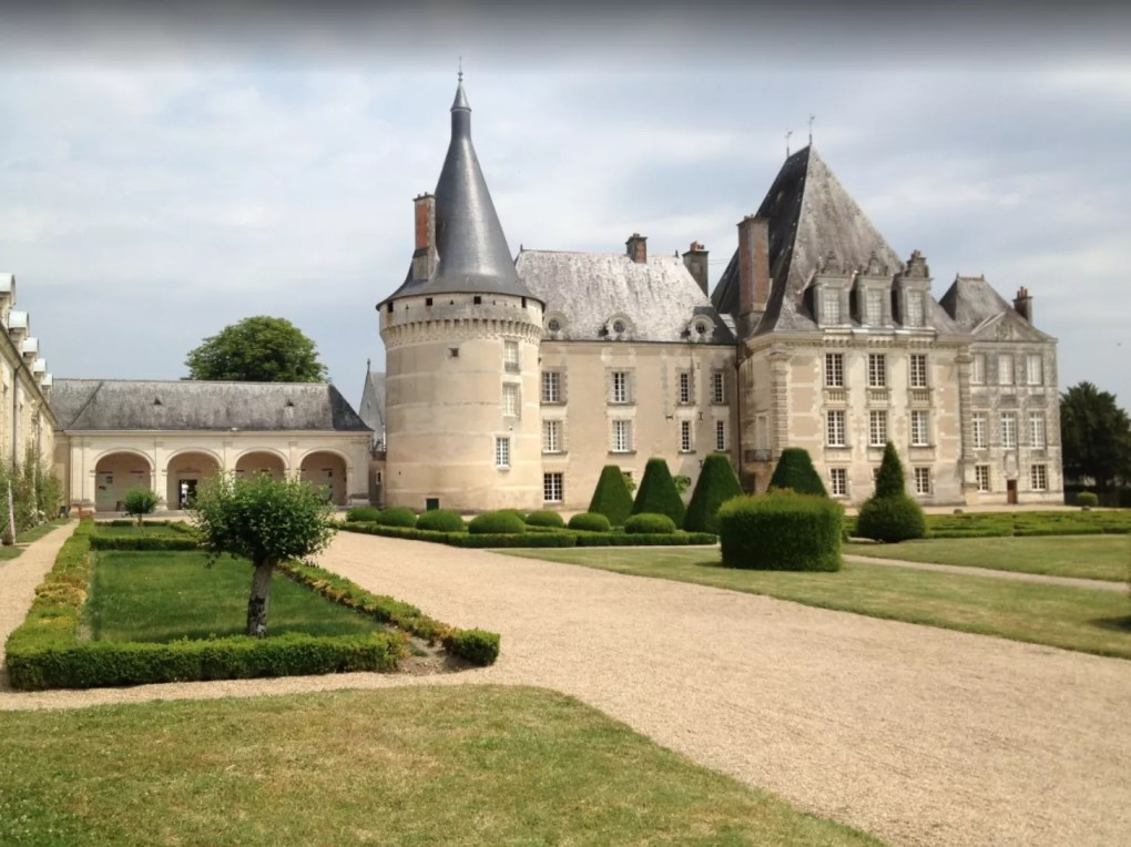 A French Provincial manor with a rounded tower.