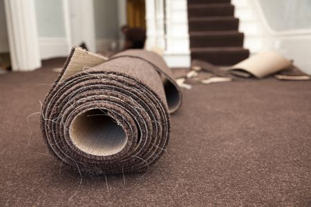 install new carpeting over old carpeting