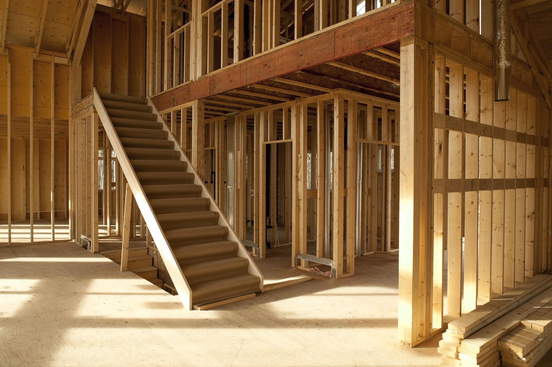 How To Keep Your Stairs Up To Code   Best Wood For Stair Stringers   Framing Square   Stair Landing   Pine Stair   Stair Tread   Deck
