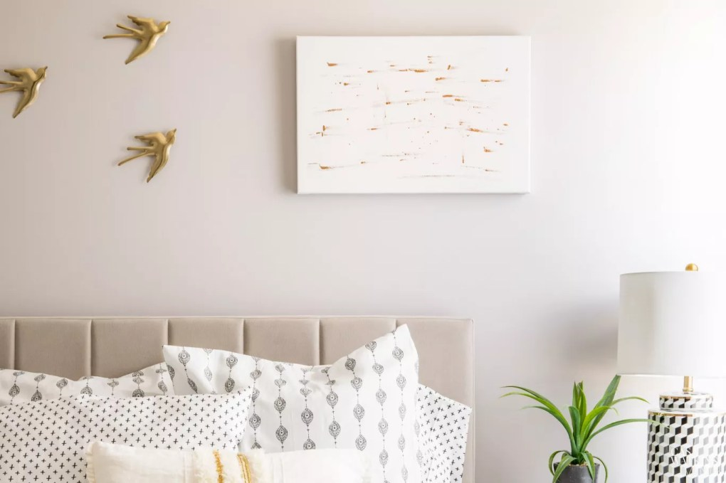 DIY glam art made with gold paint on white canvas