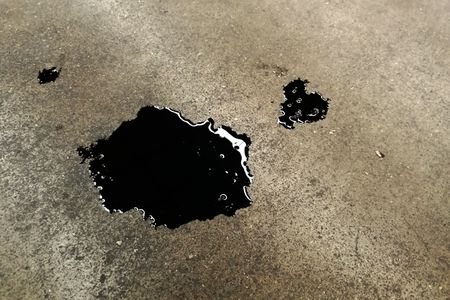 How to Clean Oil Stains From a Concrete Floor