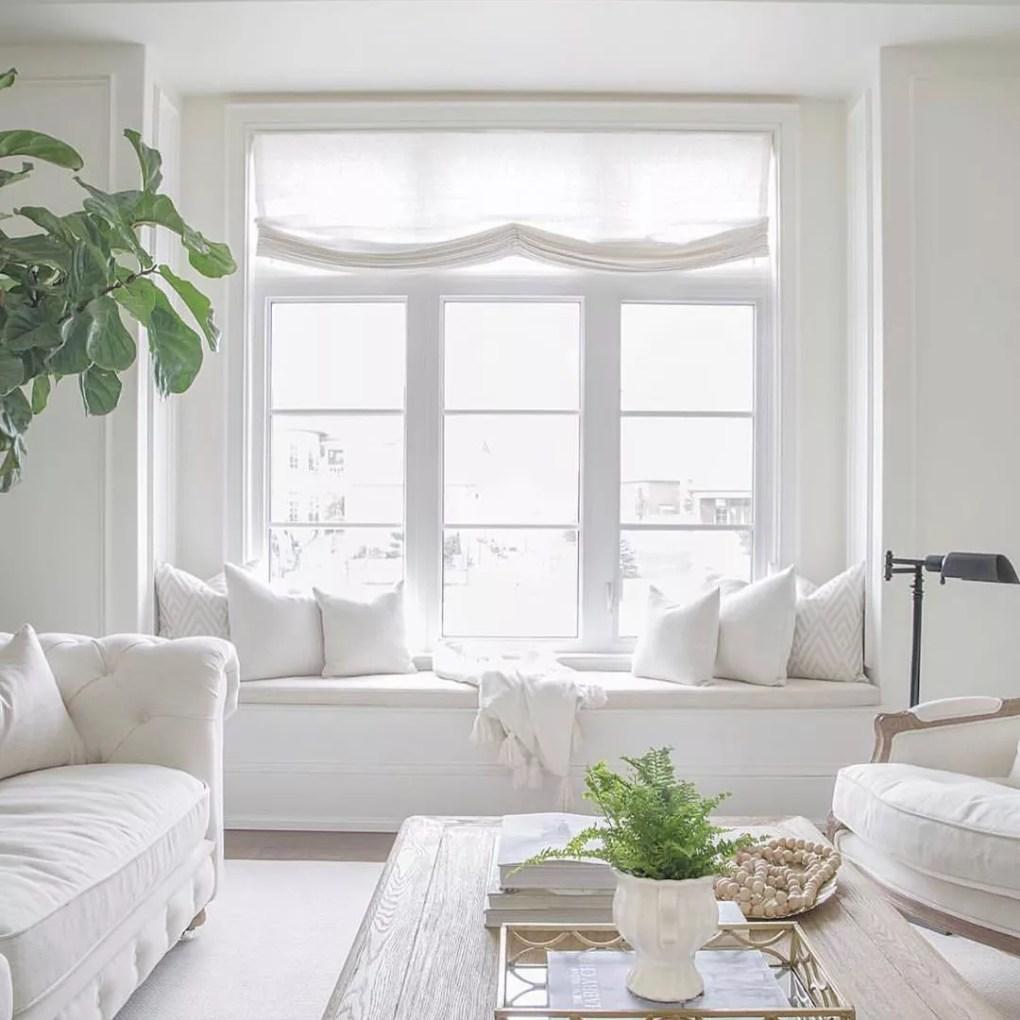 Window seat with white furniture