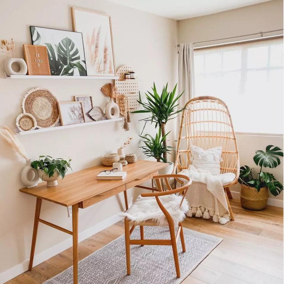 Open-shelving over a minimalist desk.