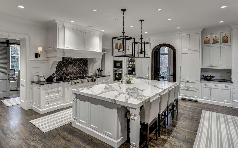 kitchens with herringbone tile backsplashes