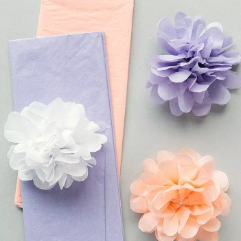 White, purple, and peach tissue paper flowers