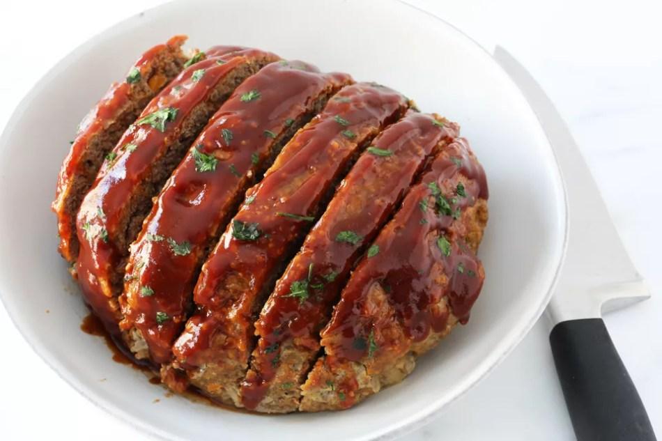 Instant Pot meatloaf in serving dish sliced.