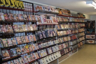 The basement of the Love Shop is stocked from wall to wall with adult entertainment videos.