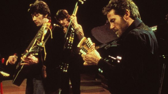 Robbie Robertson, left, in The Last Waltz, with Rick Danko, centre, and Levon Helm.