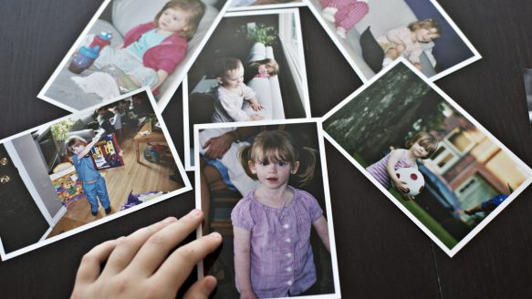 Transgender student Wren Kauffman, 11, goes through old photos of himself as a girl.