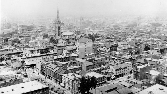 Photographer Josiah Bruce aimed his camera northwest in June 1894. St. James Cathedral dominated his view. Just before the church is St. Lawrence Market.