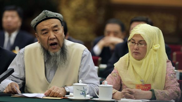 A delegate from the Xinjiang Uyghur Autonomous Region speaks during a meeting of the National People's Congress in Beijing on March 10. Critics see China's crackdown on Islam as an intensification of long-standing repression of the culture and rights of Xinjiang's ethnic Uighur people, who face widespread economic and social discrimination.