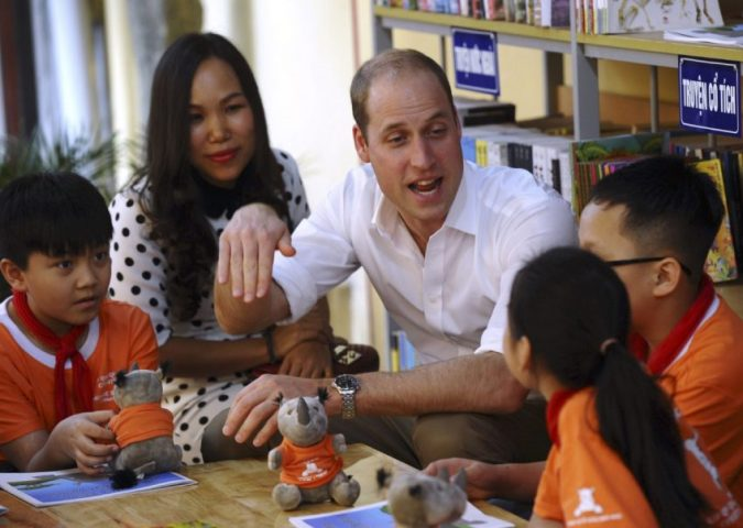 William, shown here at a school in Hanoi, also joined local celebrities, traditional medicine experts and wildlife activists at a coffee shop for a discussion about changing social attitudes toward the use of illegal wildlife products.