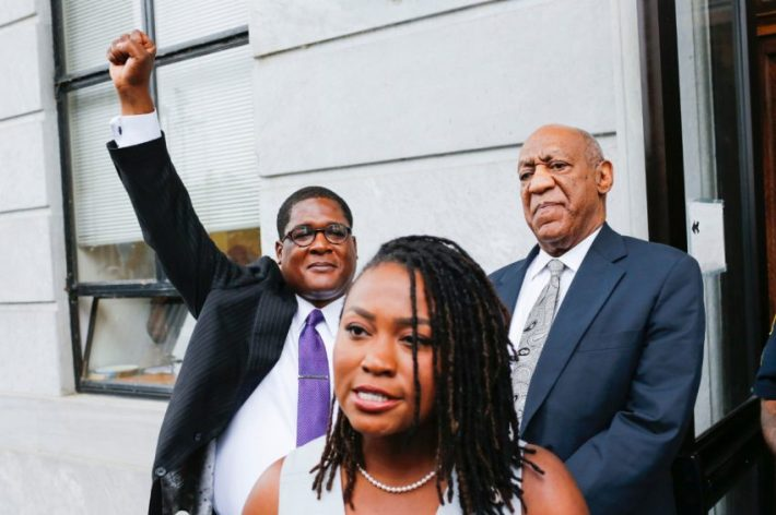 Bill Cosby looks on as his spokesperson Andrew Wyatt, left, celebrates as they exit the courthouse after Judge Steve T. O'Neill declared a mistrial.