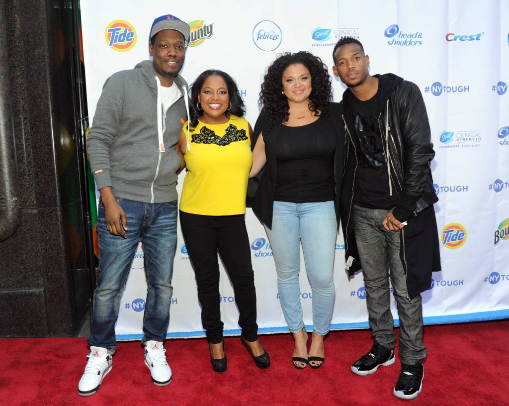 Comedians Michael Che, Sherri Shepherd, Michelle Buteau and Marlon Wayans, left to right, pose for a photo before sharing their #NYTough experiences with a comedy showcase at Carolines on Broadway
