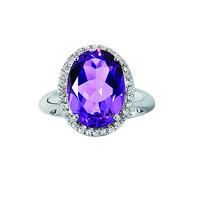 Big and bold yet so ever so sophisticated in both style and design, this amethyst and diamond ring is meant to be seen. A 4.50 carat amethyst is the center of attention surrounded by the sparkling spotlights of .10 ct. t.w. of diamonds. The eye-catching setting is further enhanced by the cool sheen of sterling silver for a look that can't be missed.