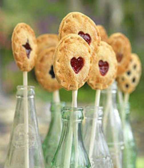 Mini milestones deserve a mini reward, like these Cherry Tart pie pops, that use sour cherries for that added tart punch, and their signature heart peek-a-boo crustis adorable, fun and easily versatile.