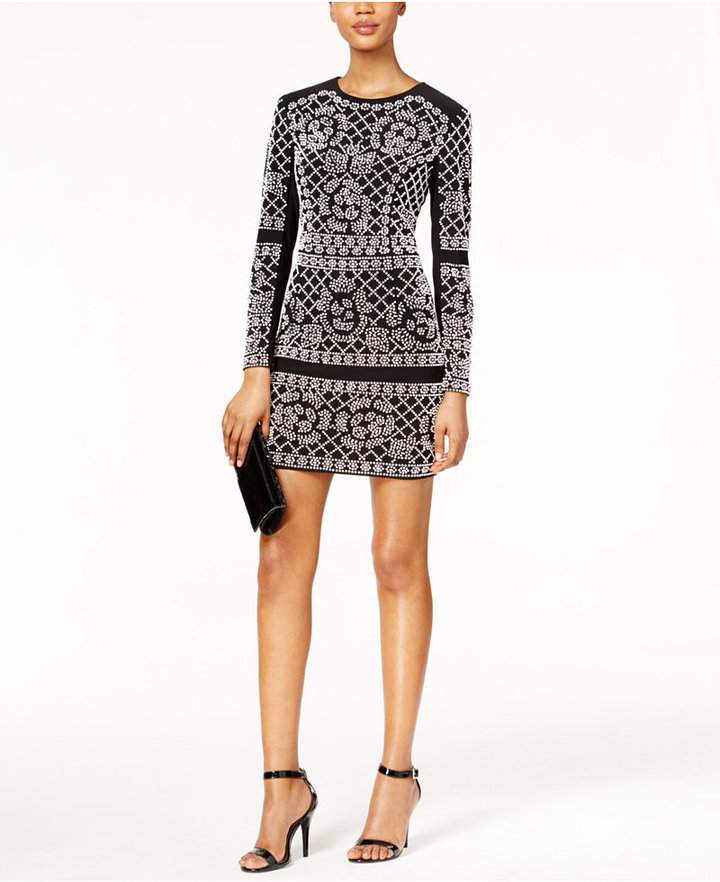 The night will be your in this unforgettable embellished mini dress by Xscape -- heads will turn!