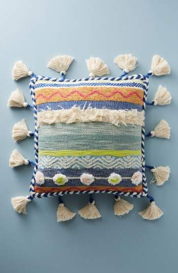Inject a bit of vintage character into any space with a distinctive accent pillow featuring textured stripes and a tassel border.