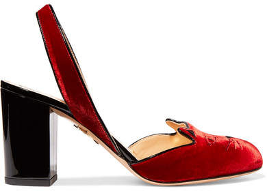 Made from red velvet, this elevated version is set on a comfortable patent-leather block heel and embroidered with a feline at the toe. The elasticated slingback strap ensures all-day comfort.