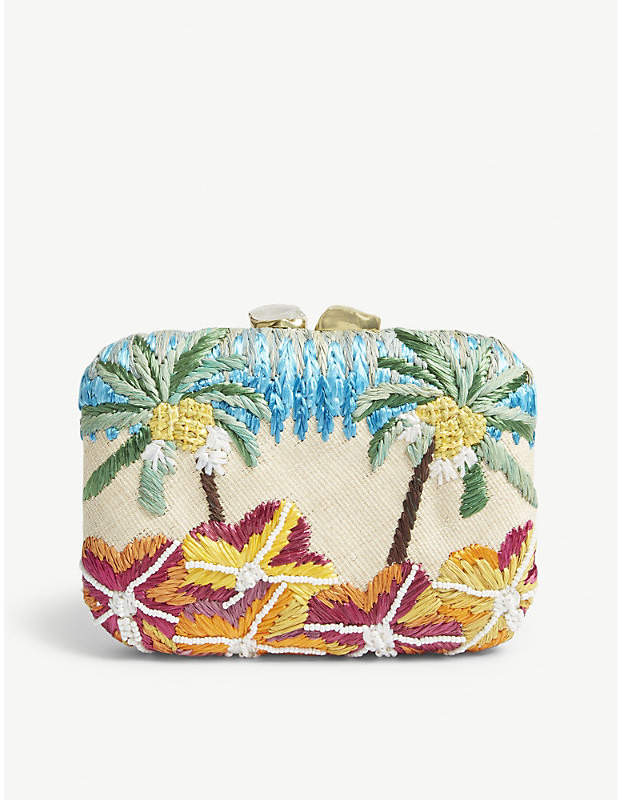 A champion of tropical influences and native craftsmanship, Aranaz draws from its island home of the Philippines. Accented with beads for definition, this raffia box clutch is defined by its floral and palm tree motif that contrasts with the gold toned metalwork and stone embellished clasp, finished with an interior slip pocket and plaque.