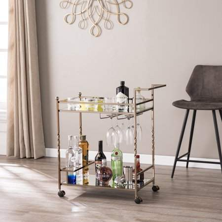 Stack up your style with this double-decker mirrored bar cart. Two mirrored shelves reflect your bar collection, while stemware racks and bottle holders keep your items easily accessible and neatly organized. A conveniently placed handle pairs with locking casters, ensuring fluid movement between various entertainment spaces in your dining area or open concept living space