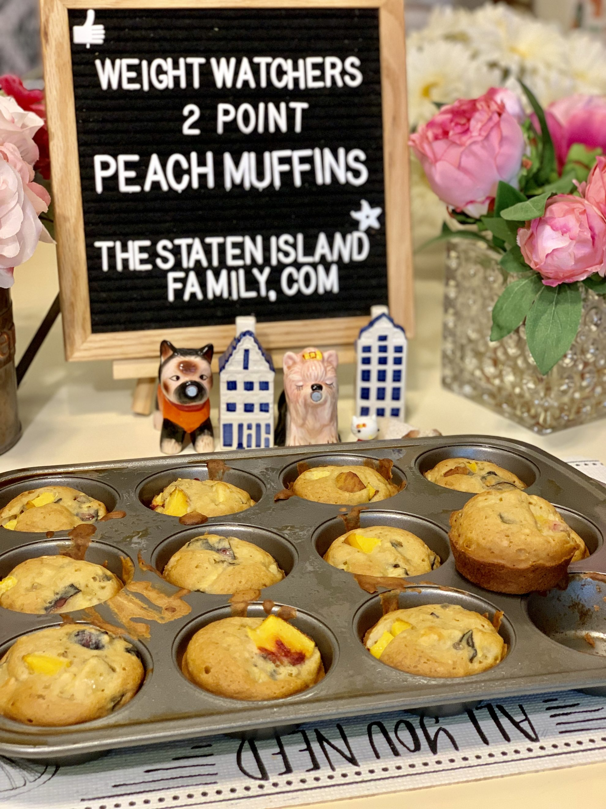 these Weight Watchers Peach Muffins -are just two points each. made the old fashioned way with flour (no cake mix) and they are so delicious! get the recipe here: https://www.thestatenislandfamily.com/weight-watchers-peach-muffins/