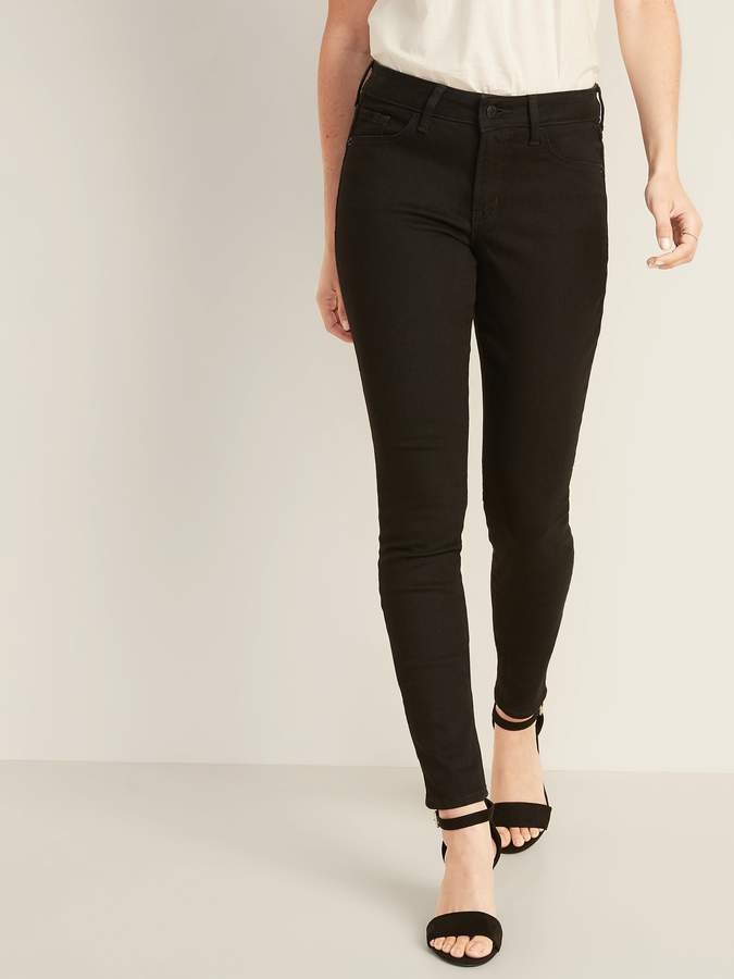 Universally flattering for all shapes, including straight and curvy. Button closure and zip fly. Riveted scoop pockets and coin pocket in front; patch pockets in back. Soft black denim wash, with comfortable stretch to flatter all shapes. Never-Quit Shape Retention holds its shape and hugs in all the right places, wear after wear. Tag-free label inside back waist for added comfort.