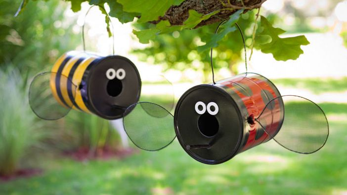 Create a buzz with these bumblebee and ladybug decorative birdfeeders made from repurposed paint cans.