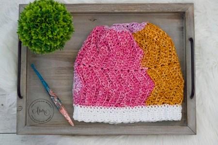Spring Tranquility Messy Bun Hat - Free Crochet Pattern #ScarfHatoftheMonthClub2020 | www.thestitchinmommy.com