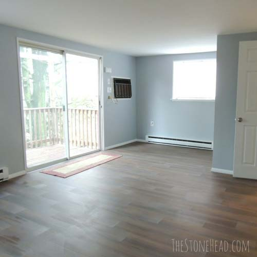 living room apartment remodel with luxury vinyl plank flooring