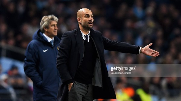 Josep Guardiola the head coach of Bayern Muenchen gestures as Manuel Pellegrini the manager of Manchester City looks on during the UEFA Champions League Group E match between Manchester City and FC Bayern Muenchen at the Etihad Stadium on November 25, 2014 in Manchester, United Kingdom.