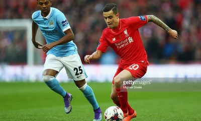 Philippe Coutinho of Liverpool is chased by Fernandinho of Manchester City during the Capital One Cup Final match between Liverpool and Manchester City at Wembley Stadium on February 28, 2016 in London, England.