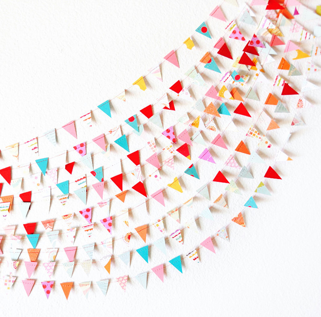 Stylish triangle paper garland for parties.