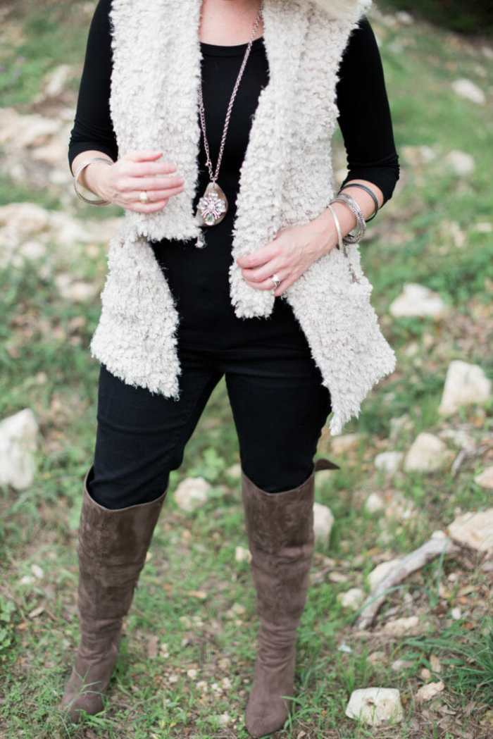 Styling a fur vest with over-the-knee boots