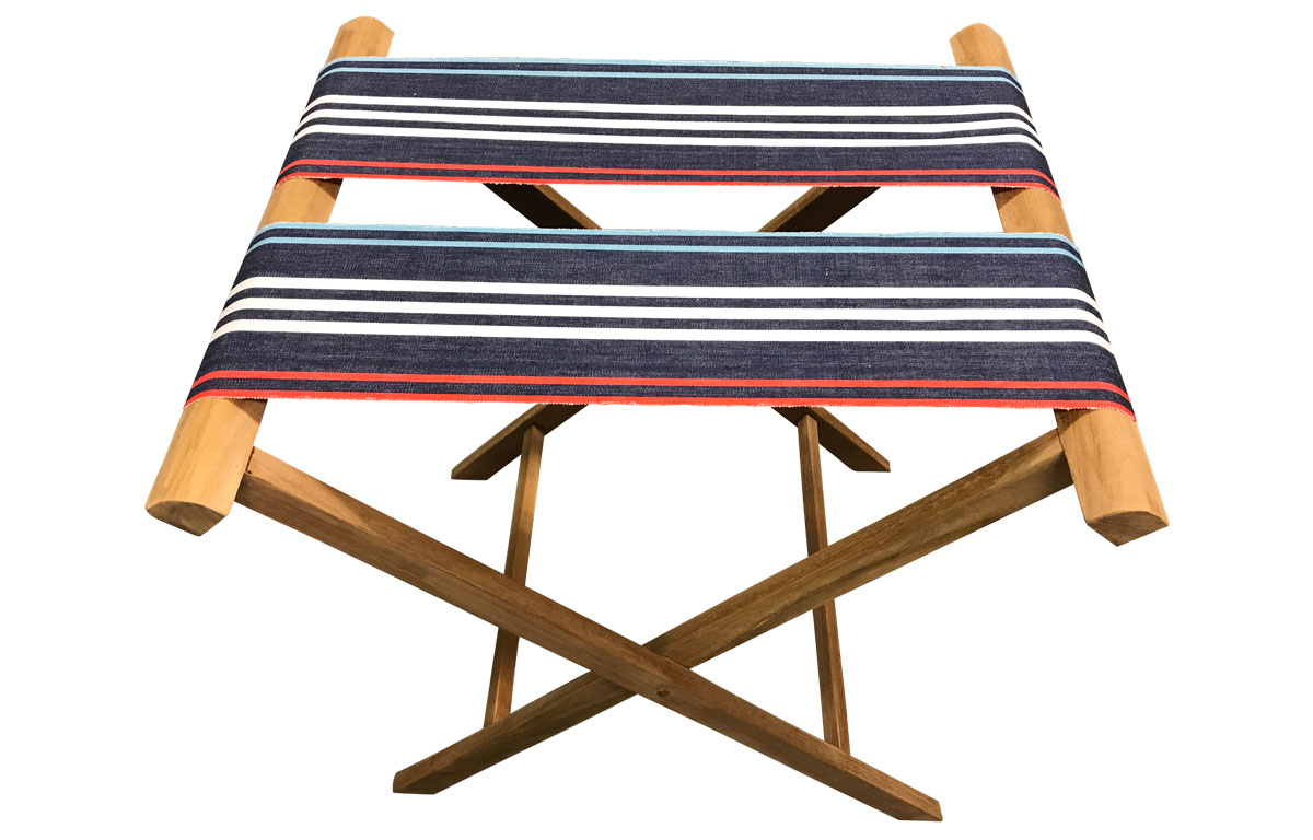 folding luggage rack with extra wide webbing of navy blue pale blue red and white stripes