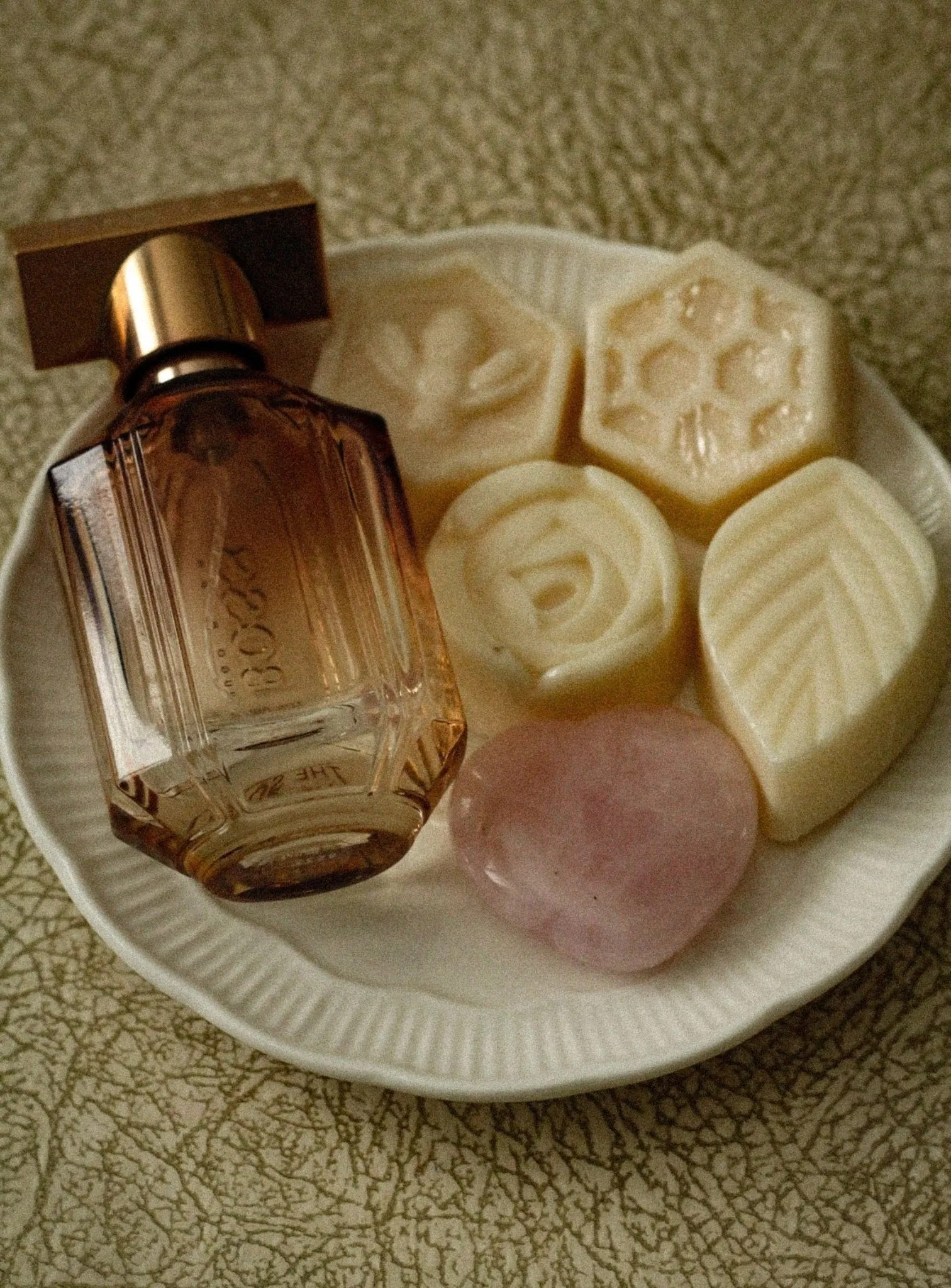 Image of perfume and soaps on plate for blog on mental health stigma