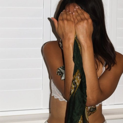 woman hiding her face for blog on feeling embarrassed of your partner - The Style of Laura Jane