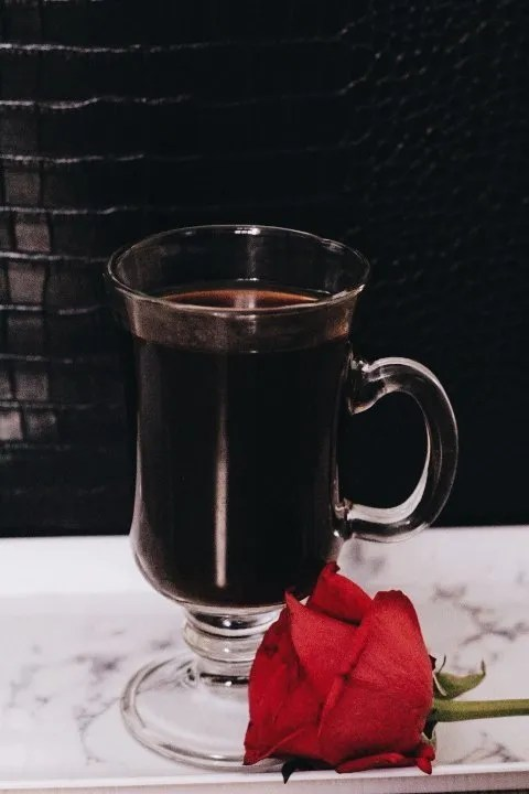 Image of black coffee and rose for blog on how to get back into dating