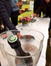 Golfers enjoy the last course of the Gastronome
