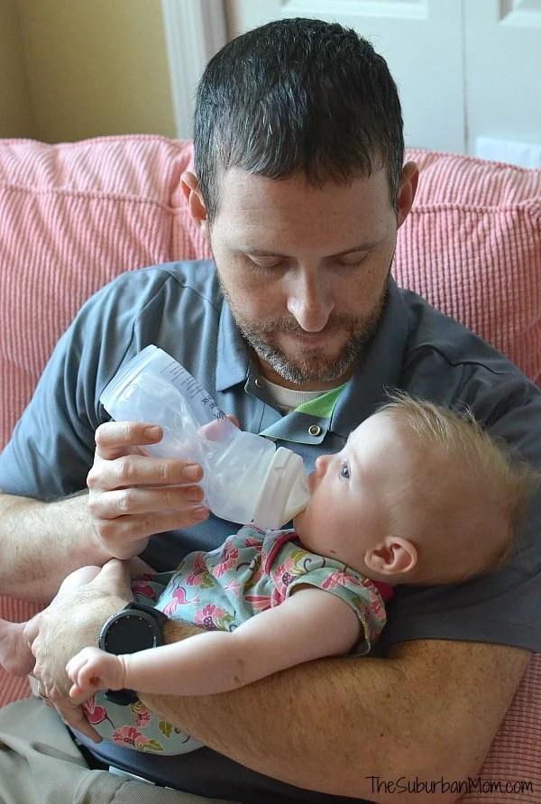 Dad Bottle Feeding Baby